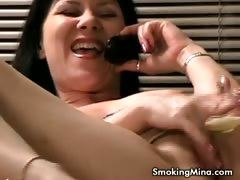 Brunette whore masturbating while having sex over the phone