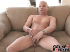 Lovely bald gay Lance masturbating his giant penis on the