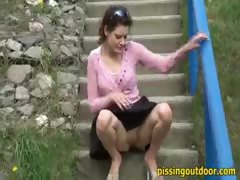 Girl pisses on the steps
