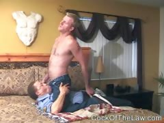 Cop gets pinned down to suck dick