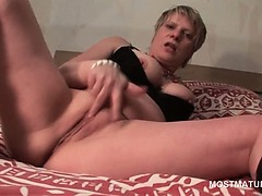 Mature tramp in leather boots finger fucking herself deep